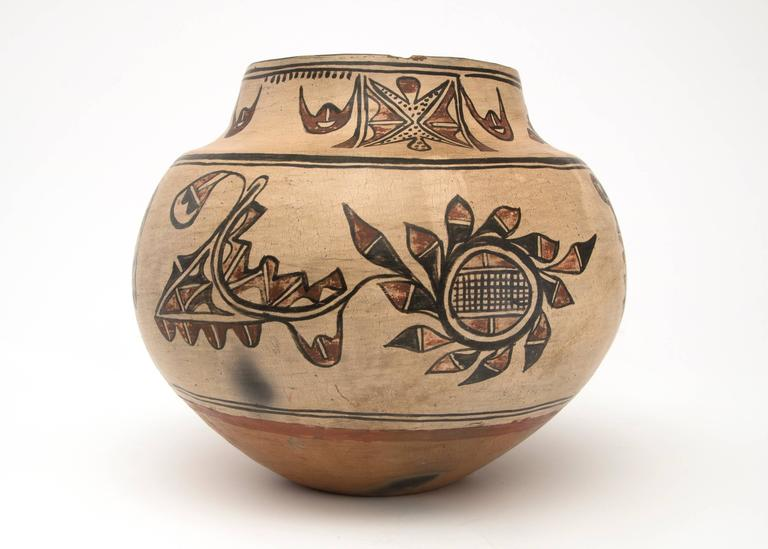 19th century Native American Southwestern Polychrome Pottery Jar created at San Ildefonso Pueblo in an olla form, circa 1875-1900. Constructed by hand and finely painted with slip glazes traditional designs.  The Pueblo de San Ildefonso (