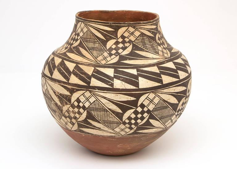Collection of Southwest Ollas from the late 19th and early 20th centuries. Jars or Ollas such as these were used for carrying water and these were all built by hand from native clay and very finely painted with slip glazes. Overall dimensions as