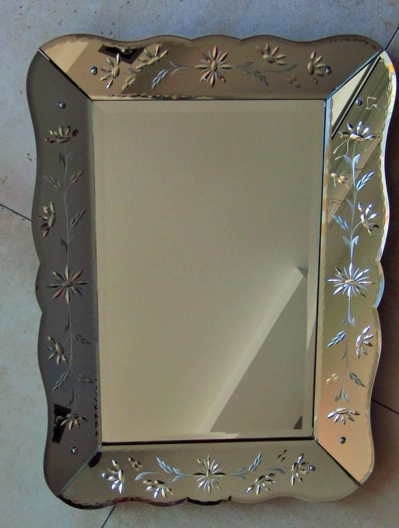 Art Deco mirror with ornament engraving, France, 1940. 100% original condition, two small lesions, see pics. Original mirror in good condition.  Note: Three dimensional with angled frame!  *** We offer door to door shipping. Please ask for your