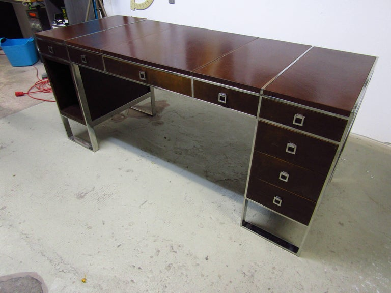 Midcentury Desk by Guy Lefevre for Maison Jansen, France, late 1960s. Good original condition. Chrome in very good condition. Front side with eight drawers. Top coated with embossed genuine leather.  Could also be used as console!