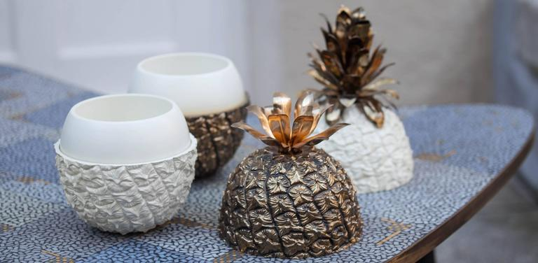 A pair of golden and white ice buckets in shape of a pineapple. Manufactured by Freddo Therm, Switzerland, 1970s. Very exclusive! Measures: Height 33 and 27 cm.