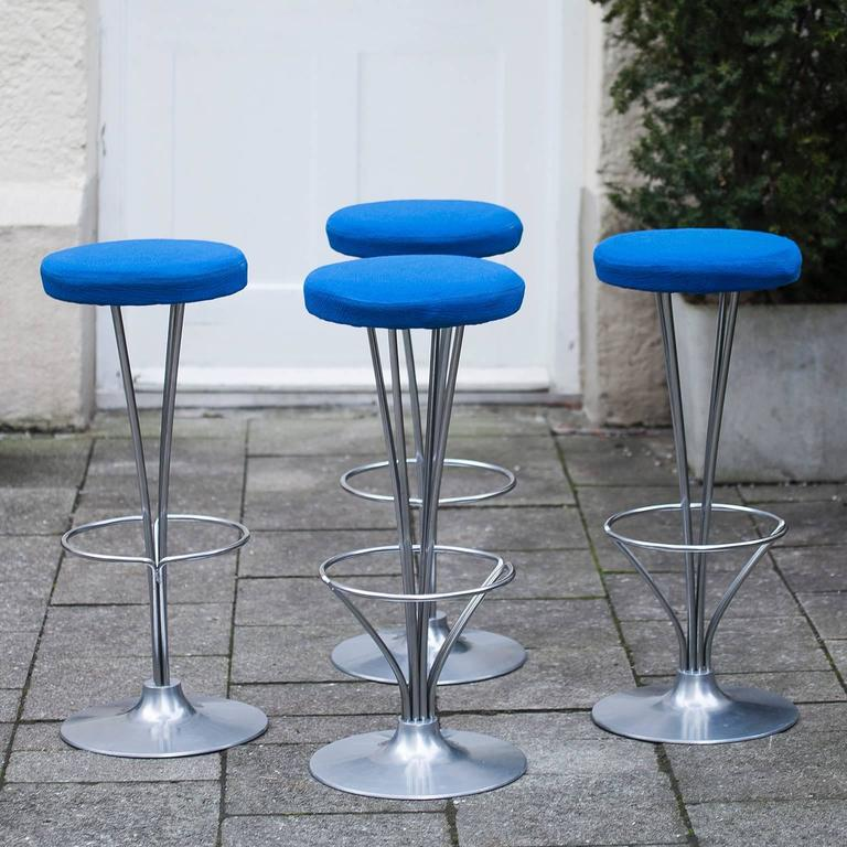 This bar stool was designed by Piet Hein, who also developed the Super ellipse table with Bruno Mathsson. These bar stools were produced by Fritz Hansen in Denmark in the 1960s and are covered with blue fabric.  Measures: H 80 x D 35 cm.