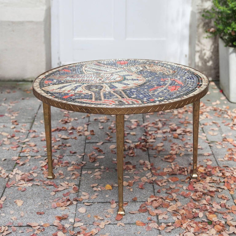 Wonderful Art Deco round mosaic table with golden bronze legs and a fantastic roman antic bird motif.