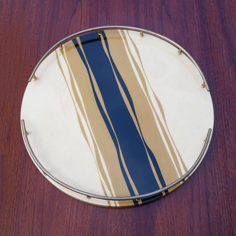 Round Aldo Tura zebra styled tray in cream, caramel and black colored goatskin with brass rail in the 1970s.  Measures: 43.5 D x 4.5 H cm.