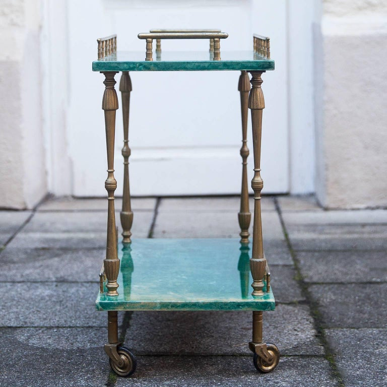 Wonderful small bar cart in deep green goatskin made by Aldo Tura, Italy, 1960s.  Measures: H 50 x W 50.5 x D 28 cm.