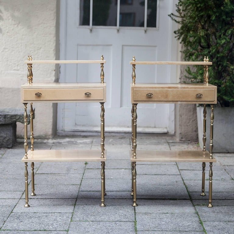 Aldo Tura cream goatskin parchment side tables or bedside tables with one drawer.