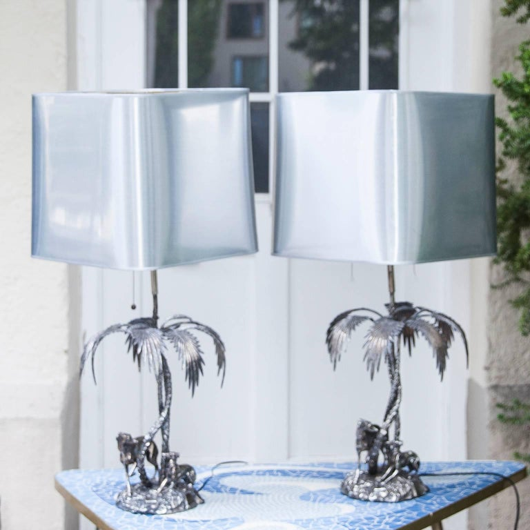 Vintage Valenti table lamps, crafted of fine quality solid silvered bronze, made in Spain 1970s. These Spanish silver plate bronze figural table lamps sculpture depicting greyhounds and palm trees. Marked on base Valenti, Made in Spain.