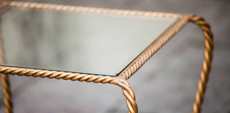 Hollywood Regency Italian gilt iron tassel and rope table.