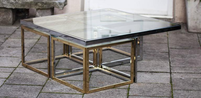 A rare Regency style bicolor low table from 1970. Manufactured and designed by Maison Jean Charles, France around 1970. Low table with 4 nesting cubes in brass and chrome.