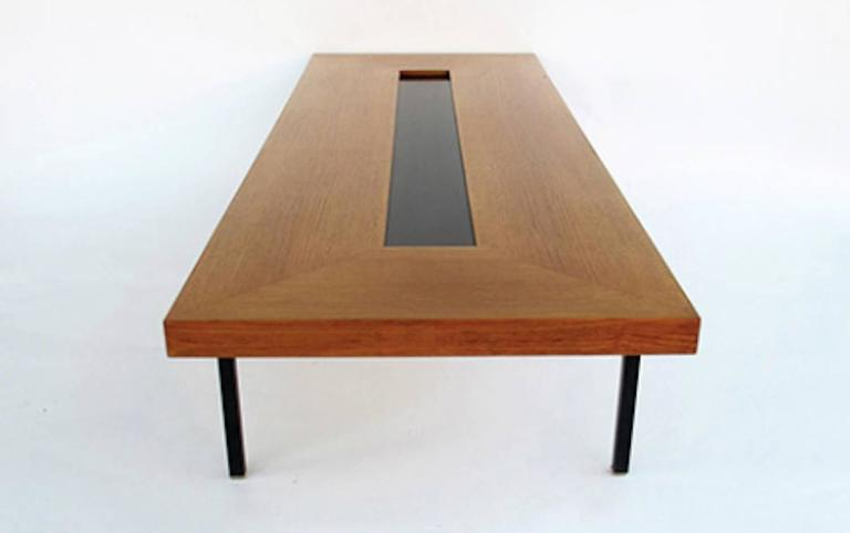 Wonderful and very rare extra large coffee table by Antoine Philippon and Jacqueline Lecoq. Black laquered steel legs and teakwood top with black laquered inlay.  LOCATED IN HAMBURG
