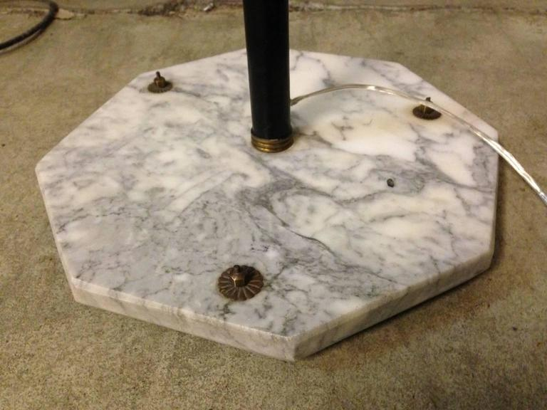 Marble base, brass details and white glass shades.