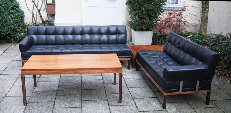 Ultra rare sofa living room set from by Johannes Spalt 1961 and made by Wittmann, Austria. The set includes a three-seat sofa which changing in a daybed, a two-seat sofa, two removable arm rests, a teak coffee table and a teak end