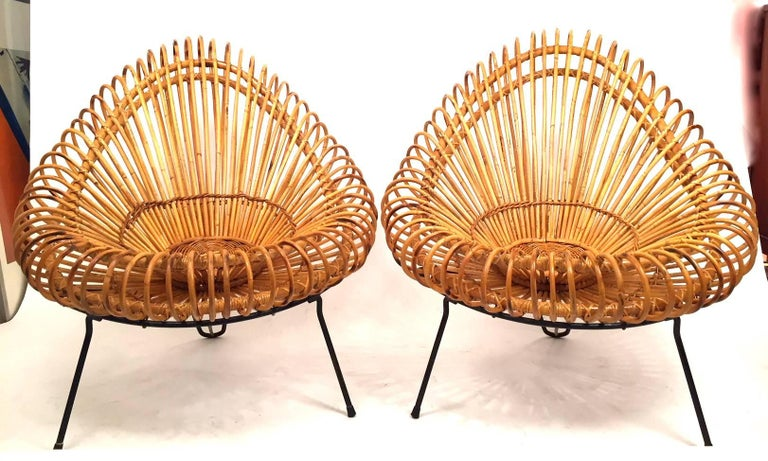 A pair of wicker lounge chairs designed by Janine Abraham and architect Dirk Jan Rol and edited by Rougier in 1955. Bamboo seat and black lacquered frame. All original. Super condition.