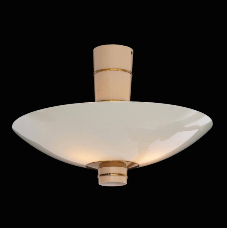 A pair of Paavo Tynell ceiling lamps edited by Taito Oy in 1940.White painted metal , brass and opaline glass. shade . Signed Taito.9055. Perfect condition.
