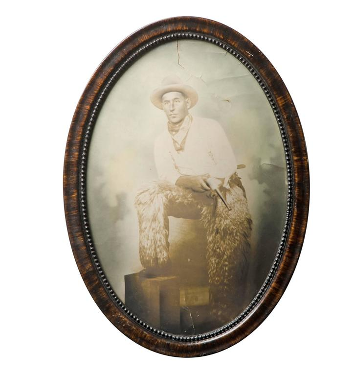Hand-Tinted Cowboy Portrait in Convex Frame, circa 1920s For Sale