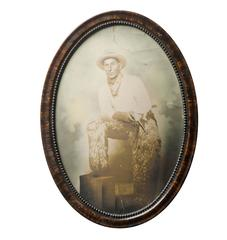 Hand-Tinted Cowboy Portrait in Convex Frame, circa 1920s