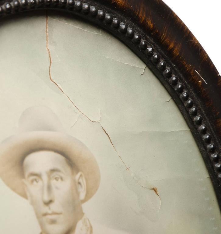 Hand-Tinted Cowboy Portrait in Convex Frame, circa 1920s In Good Condition For Sale In Portland, OR