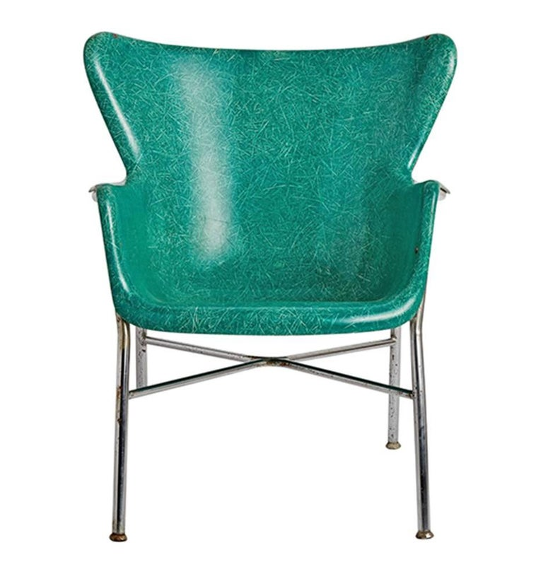 Most likely designed by Lawrence Peabody for Selig (although Luther Canover had a similar product), these remarkable fiberglass chairs are a wingbacked alternative to the Eames edition of fiberglass seating. Cradled in a polished chrome tubular