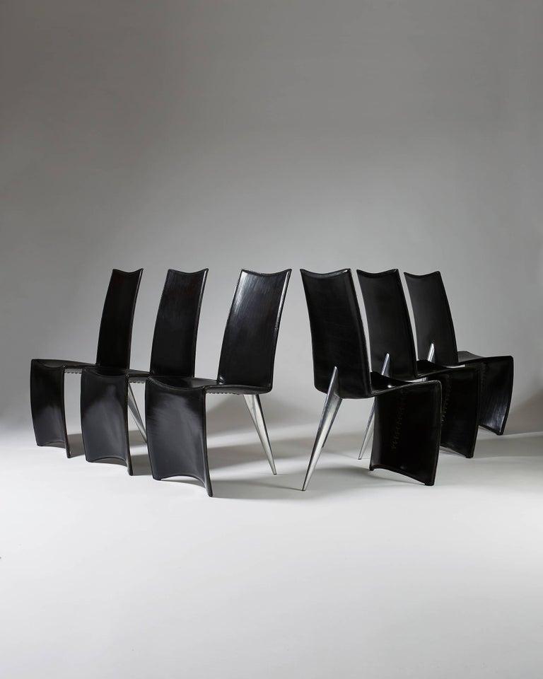 Black leather and cast aluminium.  Measures: H 98 cm/ 3' 3