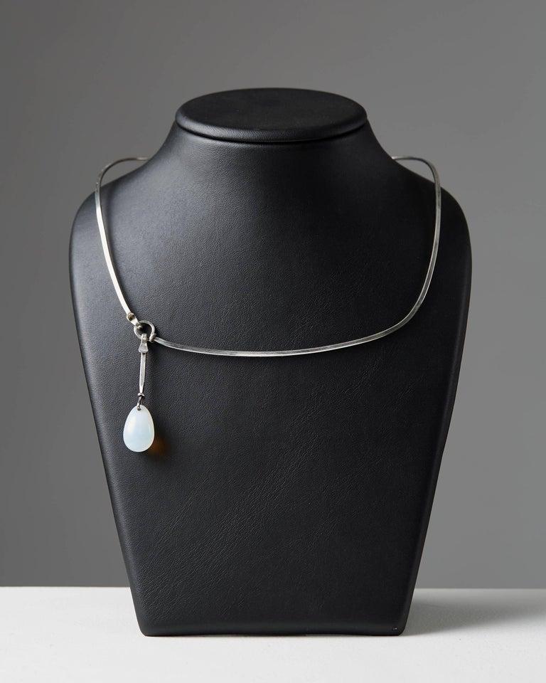 Necklace designed by Vivianna Torun Bülow-Hübe,  France, 1960s.   Cabochon moonstone, mounted in sterling silver.  Measure: Diameter approximately 14 cm/ 5 1/2