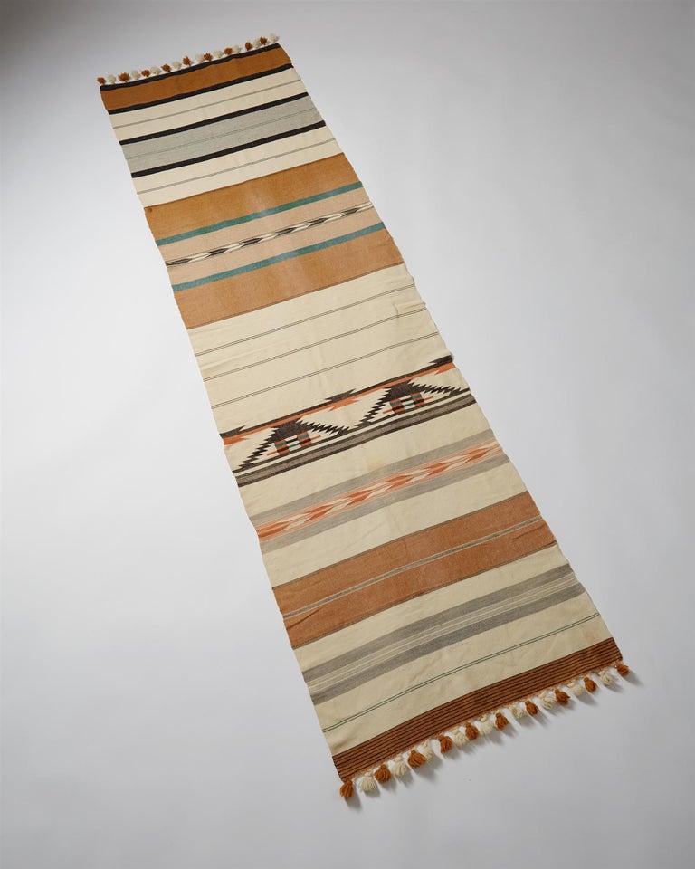 "Throw ""Sundborn"" designed by Karin Larsson. Handwoven wool."