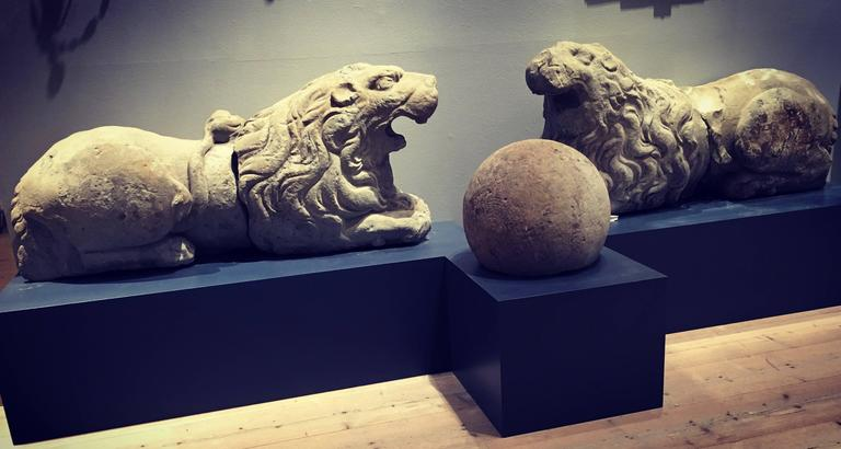 Baroque Pair of 17th Century Carved Sandstone Reclining Lions Originally Part of the For Sale