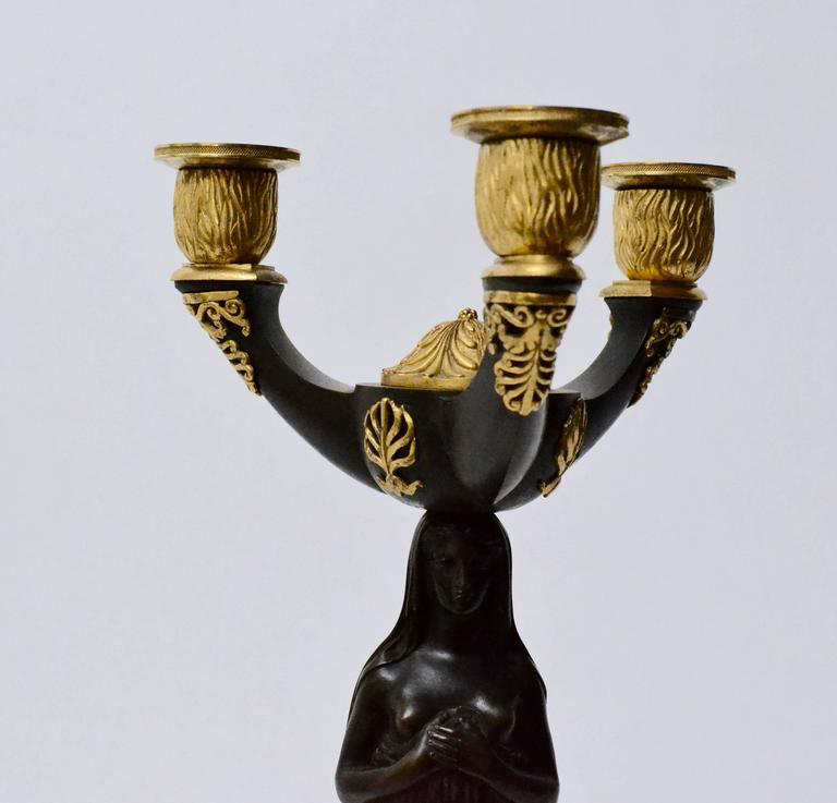 Pair of Gilt Bronze and Patinated Empire Candelabra In Good Condition In Stockholm, SE