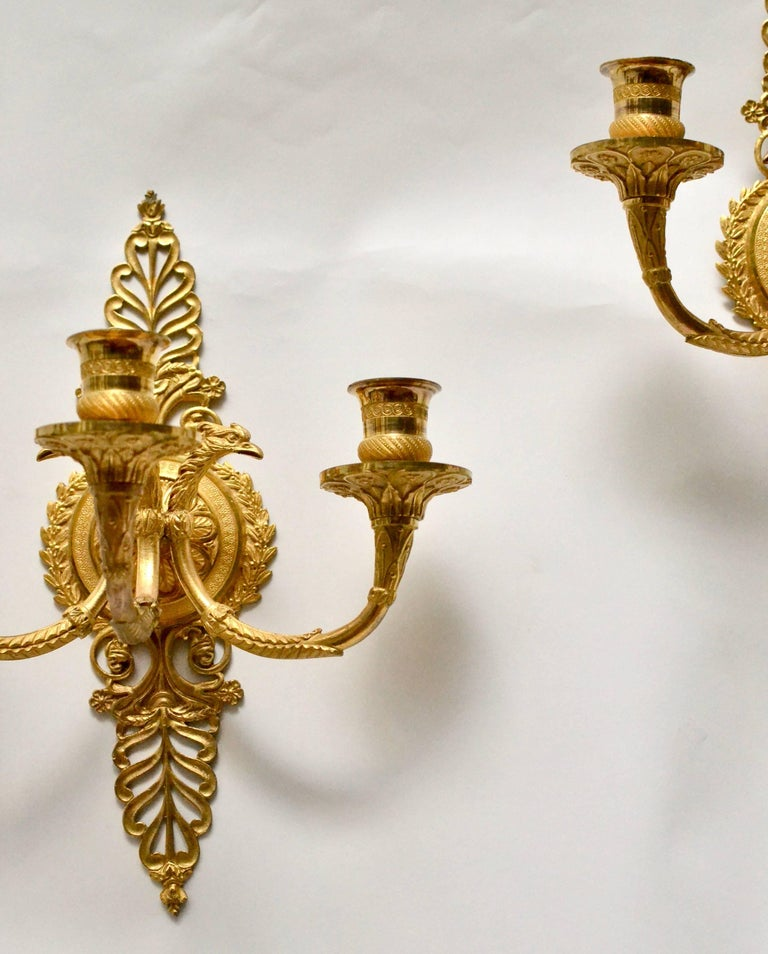 A pair of gilt bronze empire wall appliqués, early 19th century.