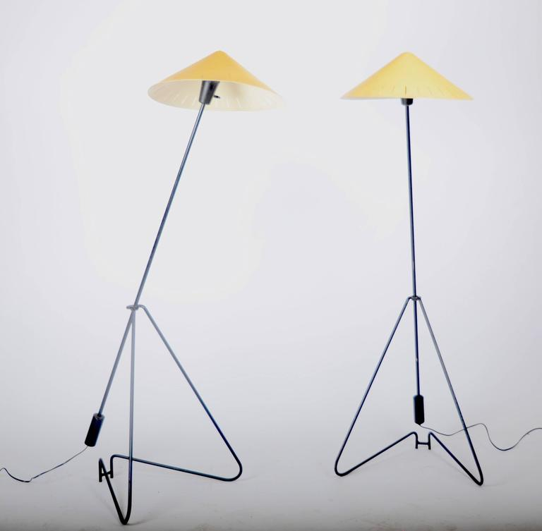 A pair of floor lamps in black and yellow lacquered metal, Sweden, 1950-1960s. Adjustable height.