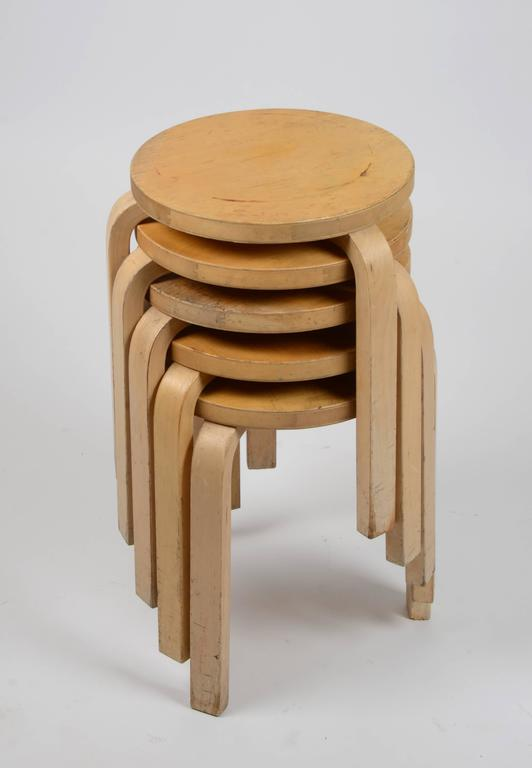 Five stacking chairs in beech, model 60 designed by Alvar Aalto in 1933.