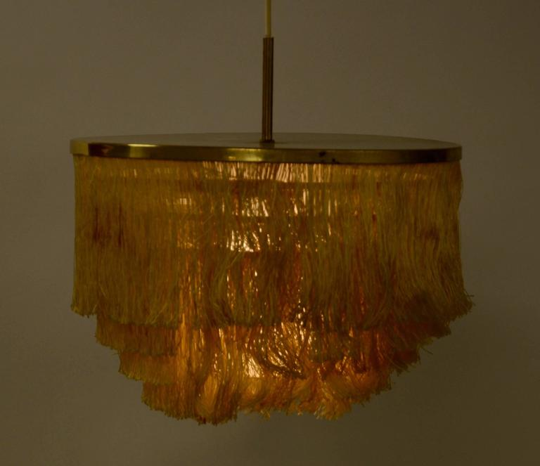 Brass pendant light with silk fringe. Designed by Hans-Agne Jakobsson for Markaryd Sweden, 1960s.