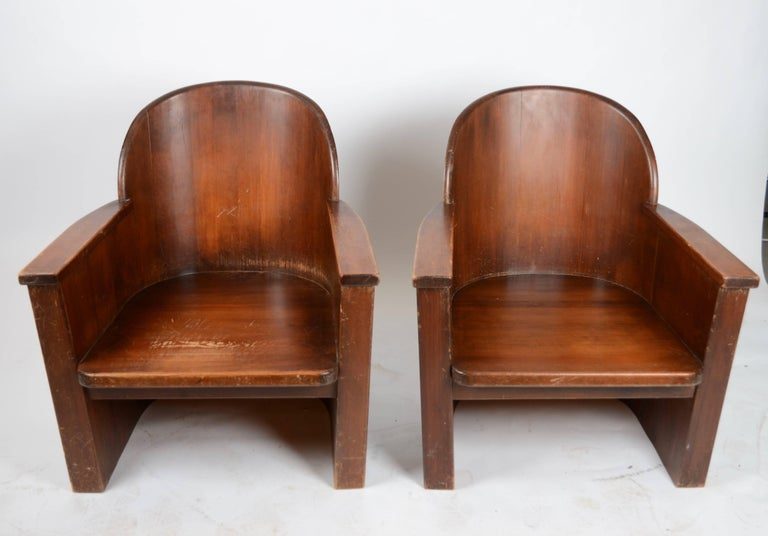 A pair of armchairs attributed to Axel Einar Hjorth for Åby Furniture, Sweden, 1950s. In pine and cast iron.