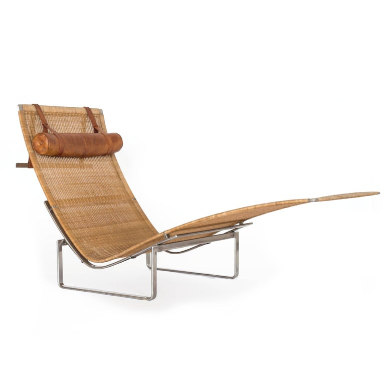 Poul Kjærholm PK-24 chaise longue with stainless steel frame, woven cane and headrest upholstered with original patinated Nigerian leather.   Designed 1965, made at E. Kold Christensen, Denmark, 1960s.  Beautiful original condition.