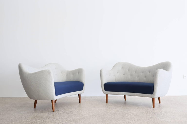 A pair of Finn Juhl sofas upholstered with fabric in grey and blue, tapering legs of stained wood.  Designed by Finn Juhl, 1946 and manufactured by Bovirke, Denmark, model BO46.  Available as a pair, sold and priced individually.   For additional