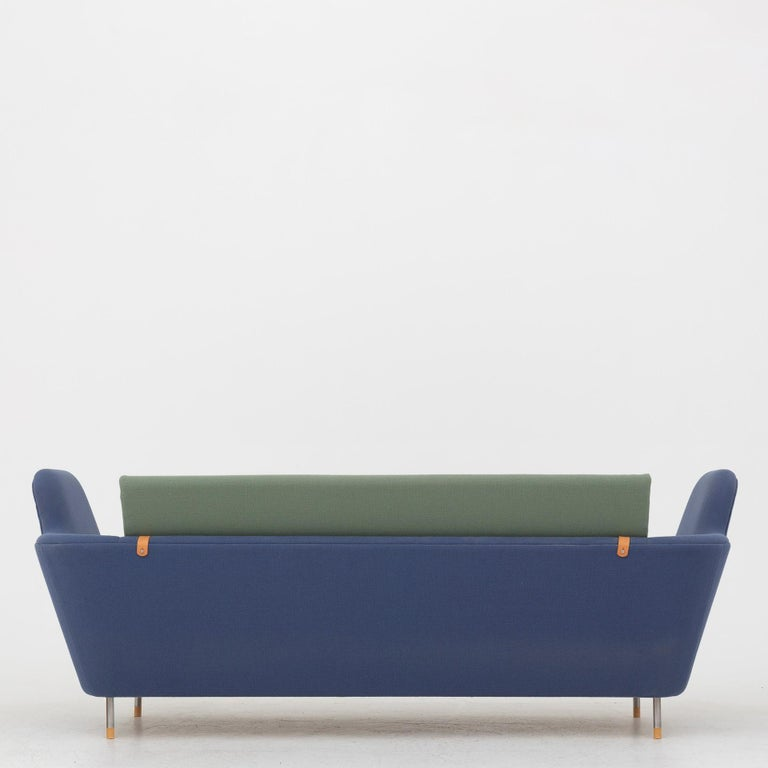 FJ 57 - 'Tivoli' sofa in blue and green wool with legs in steel and shoes of maple. Maker One collection.