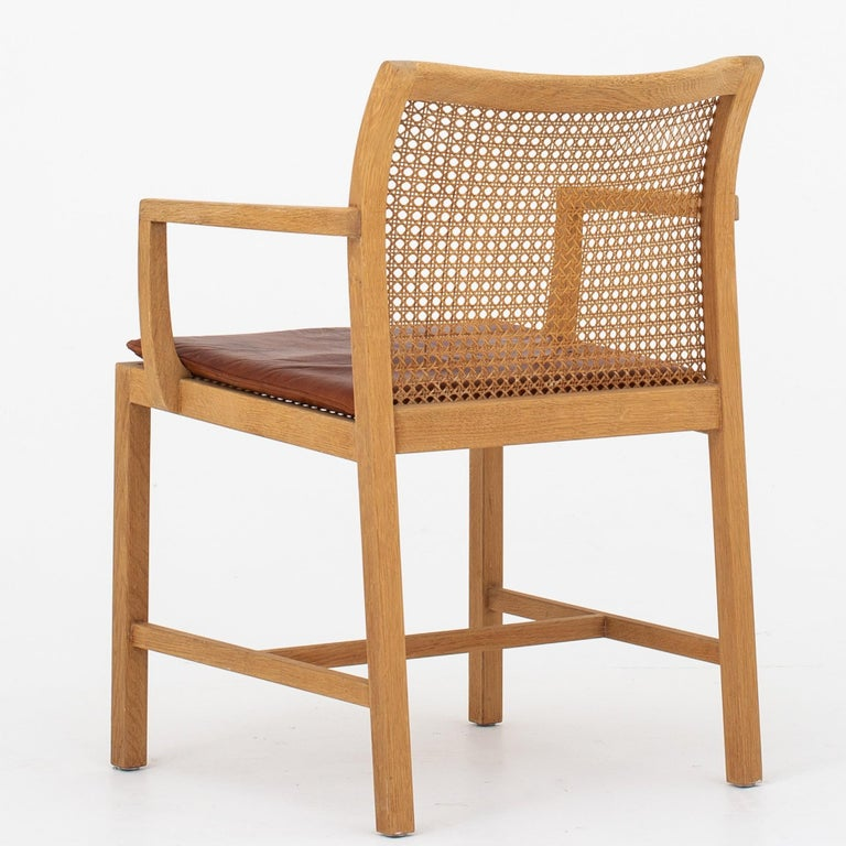 Dining chairs in oak, cane and red leather. Set of 10. Maker Søren Horn.