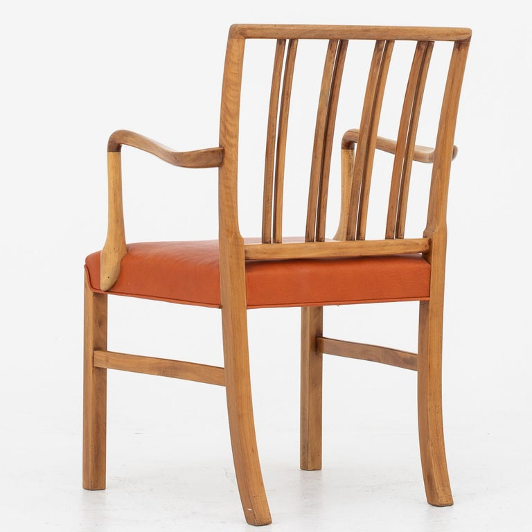 10 armchairs in walnut with seat of red leather. Maker Fritz Hansen.