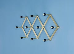 Azucena Coat Hanger in Brass with Lacquerd Wooden Knobs