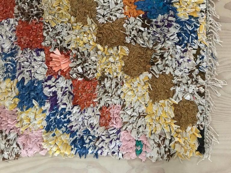 Adorable vintage multicolored Boucherouite rug.