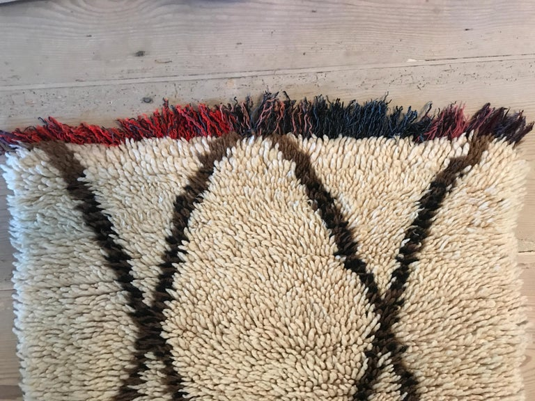 Beautiful vintage Middle Atlas rug in white and brown with colorful fringes.