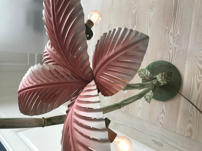 French vintage floor lamp in the shape of a palm tree with pale pink painted metal leaves.