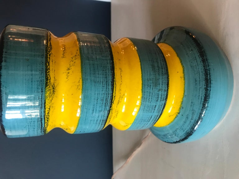 Beautiful ceramic table lamp in turquoise glaze with yellow stripes.