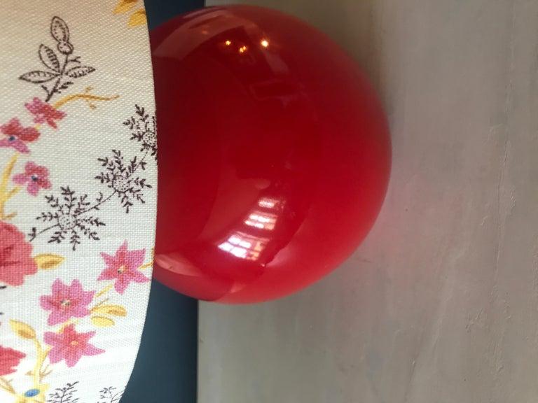 Beautiful red ceramic ball shaped table lamp.
