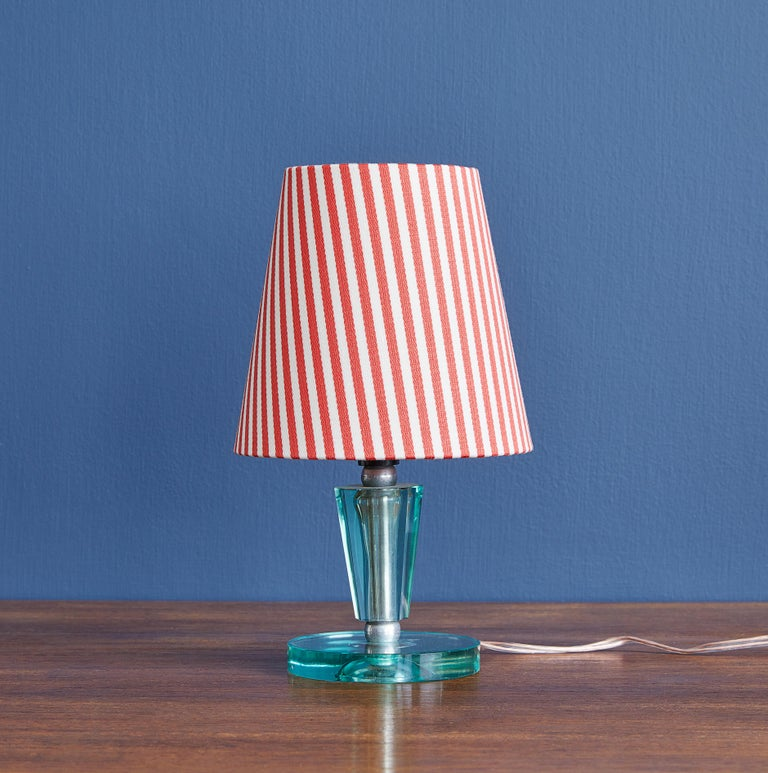 Vintage Italian table lamp in clear Murano glass with brass fittings. New linen shade with red stripes.