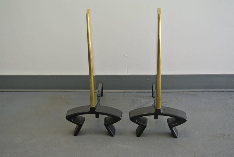 Newly restored pair of brass blade andirons by Donald Deskey for Bennett.