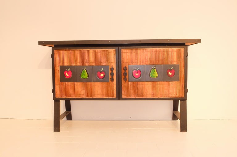 A one off wrought iron and bamboo two-door doors buffet with six ceramic plate by the charismatic French designer Colette Gueden.  Famously known for reviving the French super store Le Printemps (- the French Harrod's) with her fresh and innovative