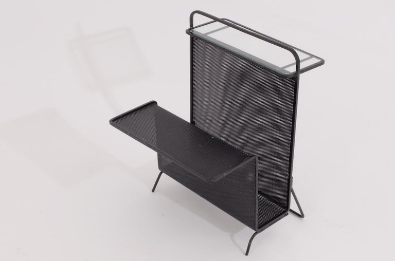 A small rarely seen table-magazine holder by Mategot in