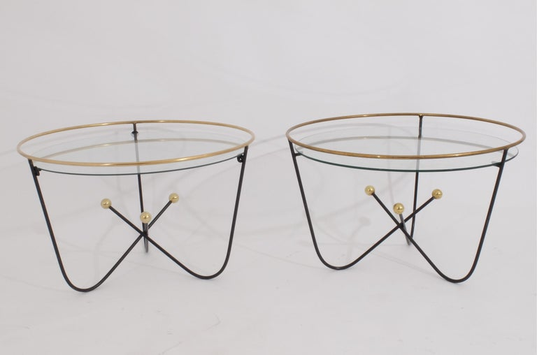 Edward Ihnatowicz for Mars Furniture and retailed by Heals London in the 1950s. These little midcentury low table are typical of the 1951 festival of Britain style championed by British designers such as Ernest Race. Painted metal and brass, glass