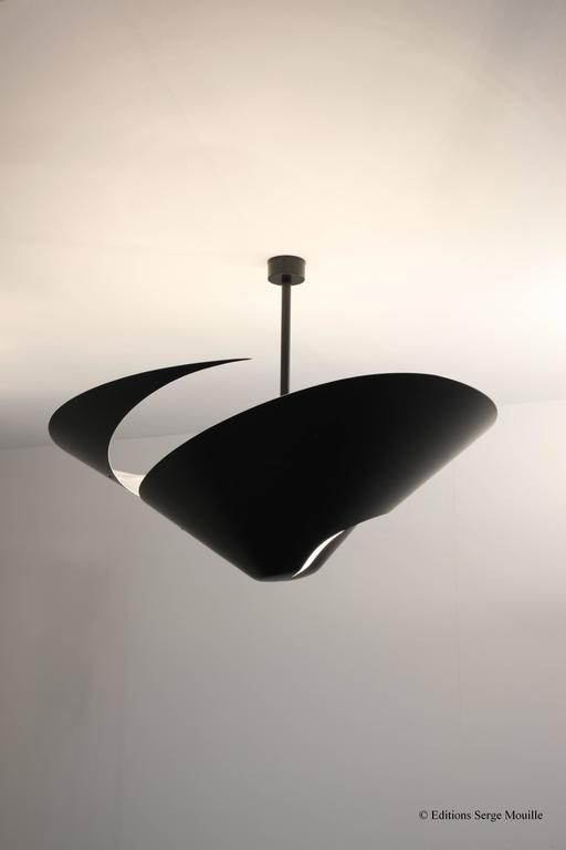 Designed in 1955 for the French airforce dining room. An extraordinary light sculpture, diam 93 Cm. In black or white  Check image 5 and image 6