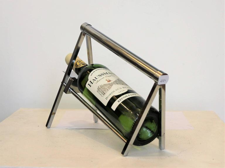 Iconic bottle carrier by Jacques Adnet (1900-1984). Chromium plated metal. Typiccal modernist style from 1930-1940.